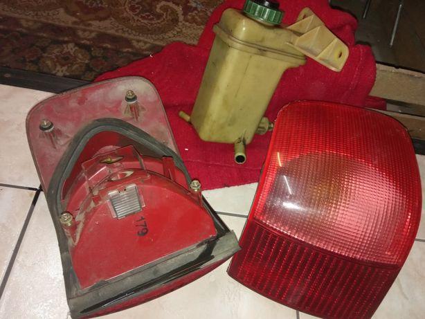 Lampy i zbiorniczek audi 80b4