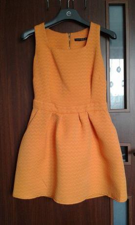Pomarańczowa rozkloszowana sukienka