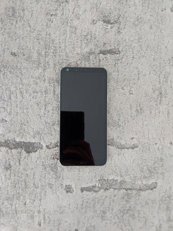 LG Q6, ładowarka, słuchawki, instrukcje