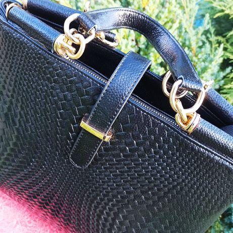 Шикарна шкіряна жіноча сумка.