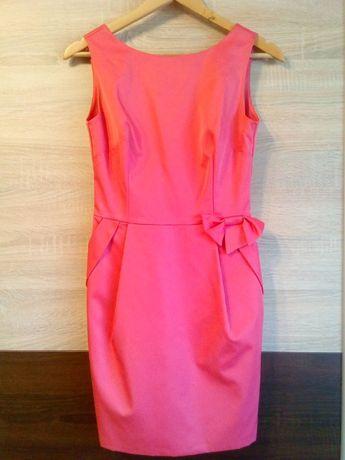 Malinowa sukienka z kokardą i kieszeniami rozmiar 38