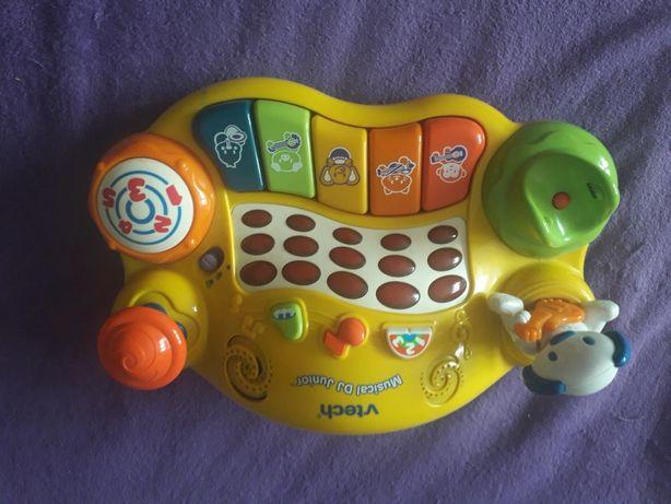 Zabawka  migajaco  grająca