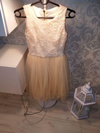 Sprzedam kremową sukienkę z tiulowym dołem