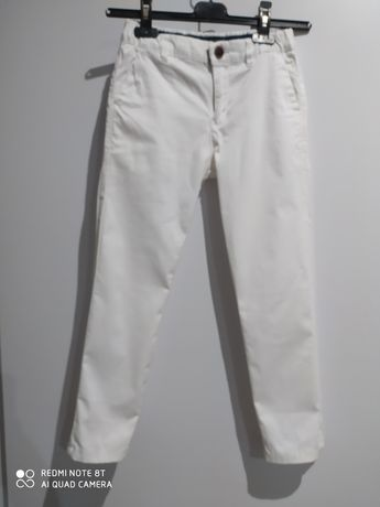 Białe spodnie 140-146