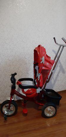 Триколісний велосипед з батьківською ручкою