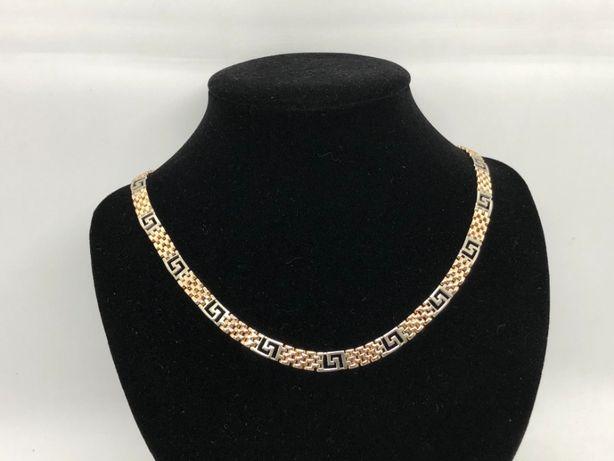 Złota kolia łańcuszek - białe i żółte złoto; próba: 585 waga: 47,10 g.