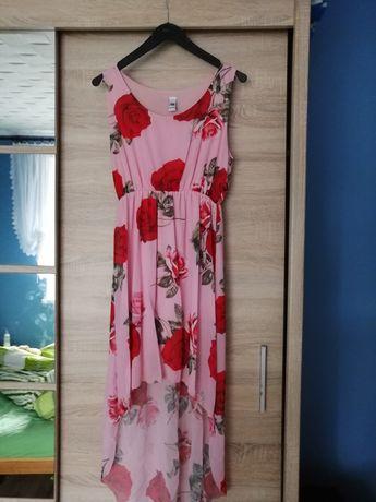 Sukienka w kwiaty z przedłużanie tyłem
