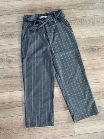 Spodnie z szerokimi nogawkami Nowe