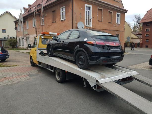 Pomoc drogowa laweta autolaweta holowanie transport samochodów