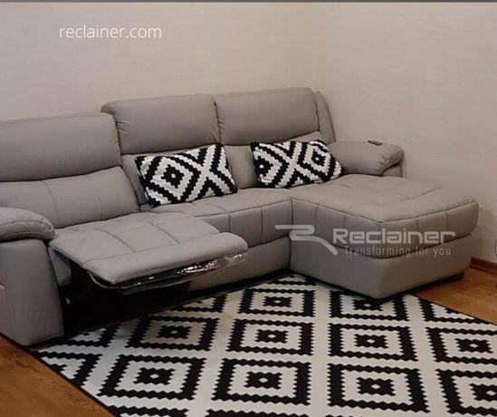 Шкіряний диван з реклайнером і отаманкою