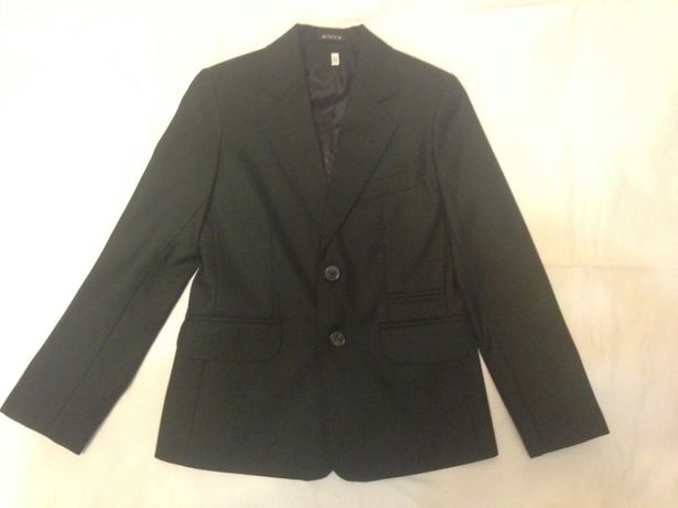 Школьный пиджак и жилетка зеленого цвета