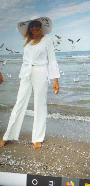 Biale spodnie Reserved roz 36