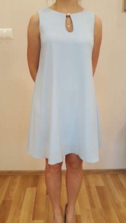 Luźna trapezowa sukienka rozmiar 40 może być ciążowa