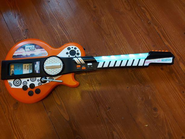 Zabawkowa grająca świecąca gitara Simba