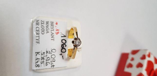 Śliczny złoty pierścionem z brylantem 0,09 karata 585
