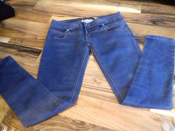 Spodnie jeansowe rurki. Dżinsy biodrówki. R.42 (L-XL). Jak nowe.