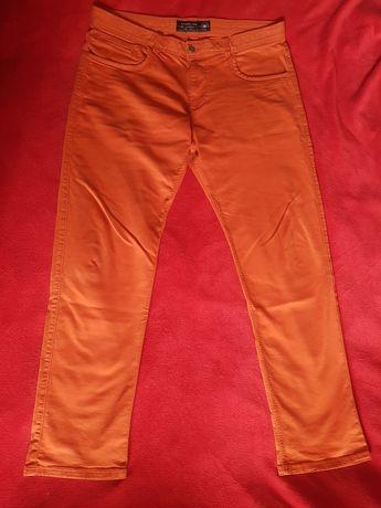 Fajne spodnie Reserved pomarańczowe rozmiar 36 jakby jeansowe, długie