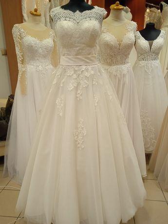 Suknia ślubna używana ecru koronka rozm.36-38