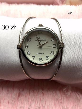 elegancki delikatny damski zegarek w kolorze srebrnym