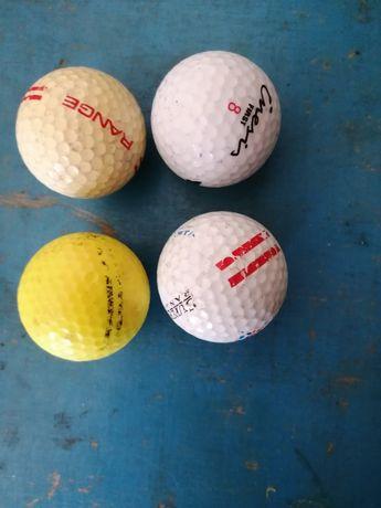 Bolas de golfe e bases de copos