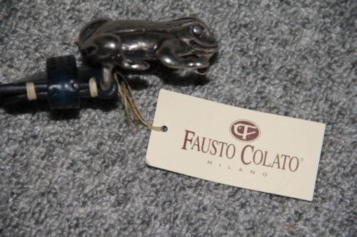 ремень fausto colato похож на versace