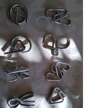Metal puzzles Quebra-cabeças