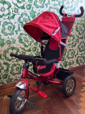 Велосипед-коляска червоного кольору