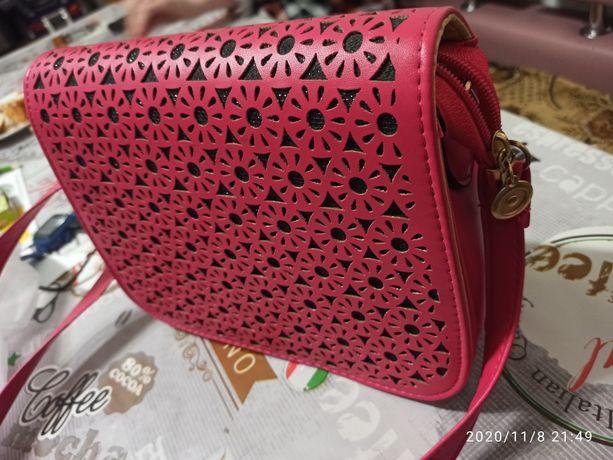 Новая, удобная, симпатичная сумочка.
