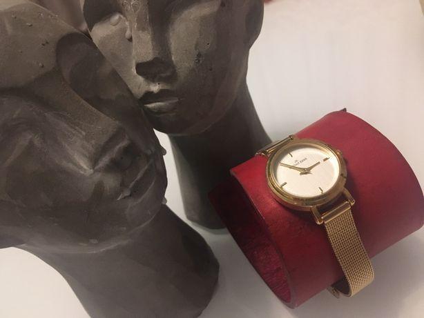 Zegarek damski , złoty - regulacja dl obwodu.