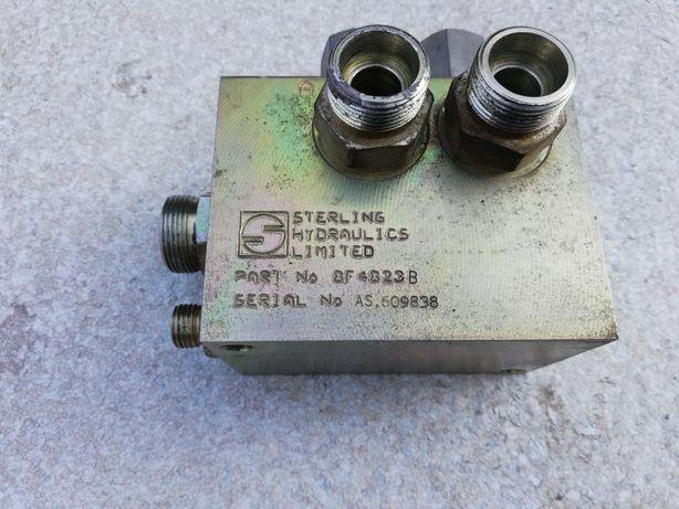 Zawór sterujący stabilizatorów Terex Schaeff HML42