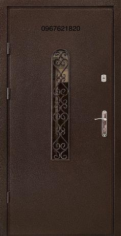Двері металеві склом та ковкою