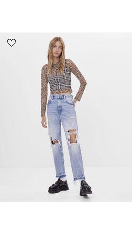 nowe jeansy z dziurami