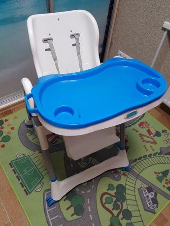 Продам стульчик для кормления на колесах