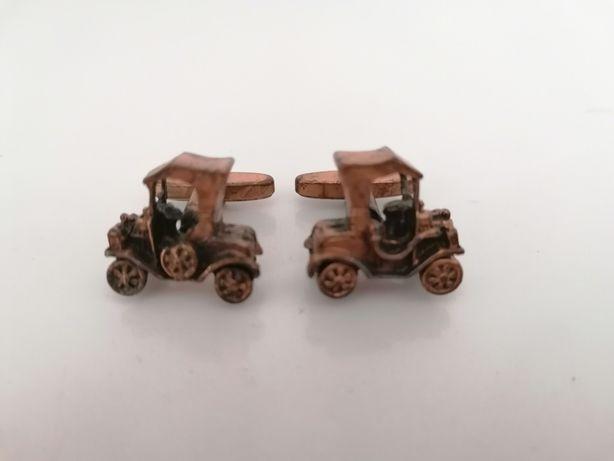 Botões de punho com carro