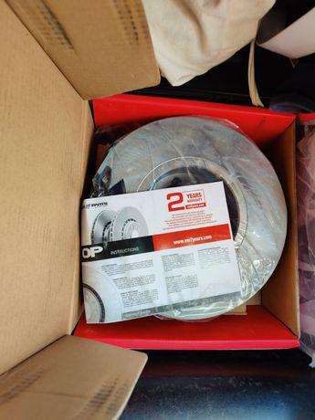 Discos e calços de travão novos e embalados