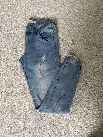 Spodnie rurki z dziurami obcisle xs/s