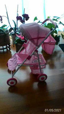 Carrinho de bonecas e bebé
