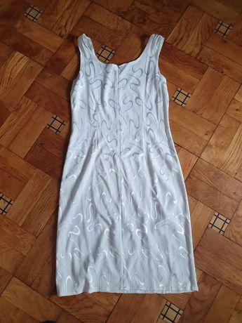 Biała sukienka dopasowana rozm.M