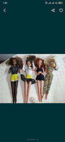 4 bonecas tipo Barbies