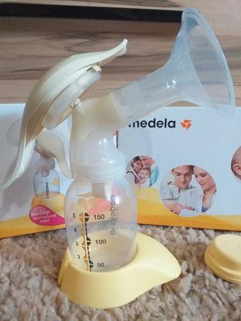 Механический молокоотсос Medela harmony +в подарок пакеты для молока