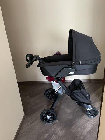 Продам: черная стильная коляска dsland stokke Торг