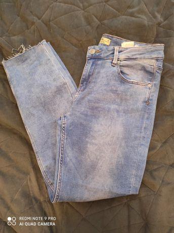 Jasnoniebieskie jeansy Sinasay
