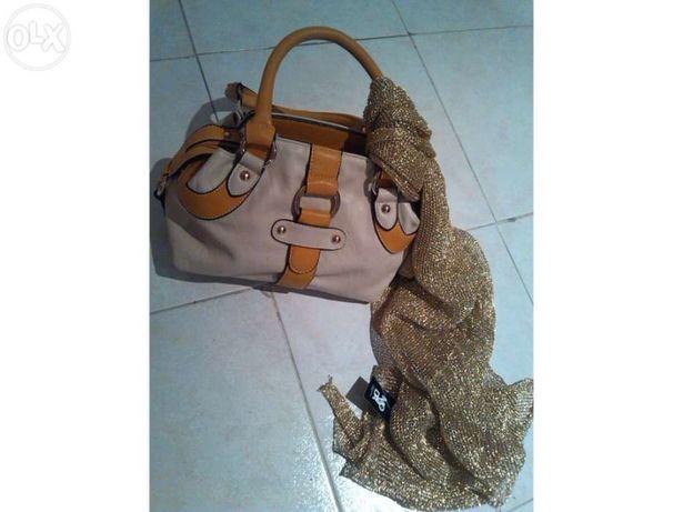 Vendo bolsa completamente nova com lenço em dourado junto
