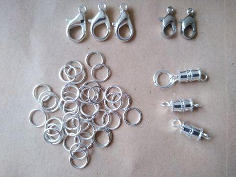 Półfabrykanty 50 elementów karabińczyki, koluszka, zakrętki.