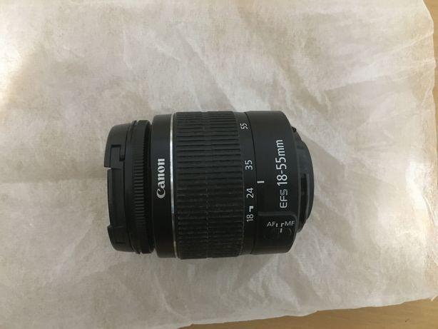 Lente Canon com carregador Canon