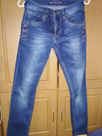 джинсы на подростка 13-14 лет .