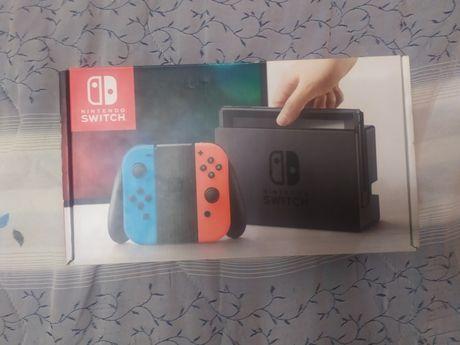 Caixa de Nintendo Switch com manuais
