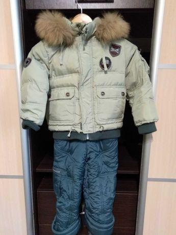 Продам зимний комбинезон 104