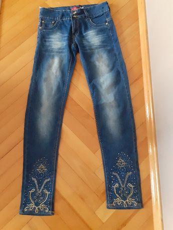 Sprzedam spodnie jeansowe dziewczęce