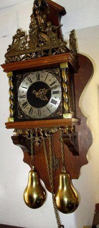 Relógio mecânico pêndulo e pesos
